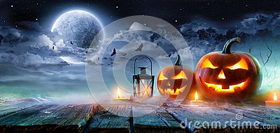 Jack O' Lanterns Glowing At Moonlight In The Spooky Night Stock Photo