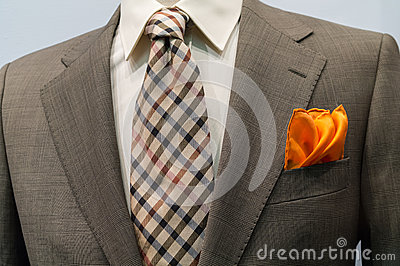 Jacket with brown checkered tie and orange handker
