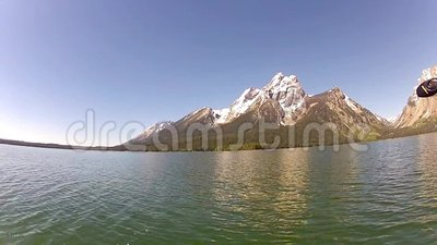 Jackson Lake and Tetons mountains. The Jackson Lake and the Tetons mountains with calm waters in late spring or early summer stock video footage