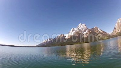 Jackson Lake and Tetons range. A view from the Jackson Lake in Wyoming with the Tetons mountain range in the background stock video footage