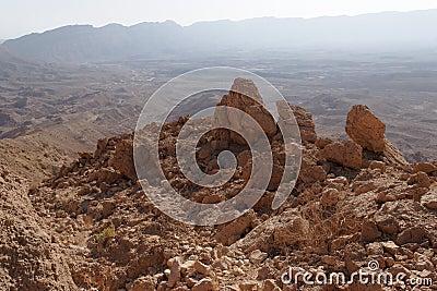 Jagged  rocks at the rim of desert canyon