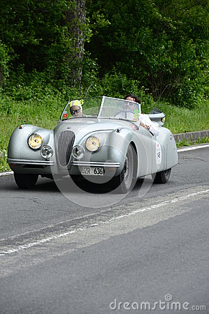 Jaguar car running in Mille Miglia race Editorial Photography