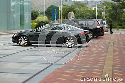 Jaguar xf parked near the office building