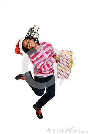 Free Jamaican Child Jumping With Christmas Gift Royalty Free Stock Image - 35650186