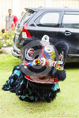 Jambi, Indonesia - January 28, 2017: Lion dance doing acrobatics to celebrate Chinese New Year Editorial Stock Photo