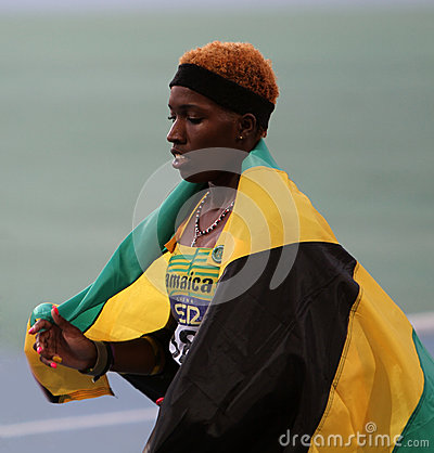 Janieve Russell from Jamaica winner of 400 m. hur. Editorial Stock Photo