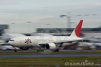 Japan Airlines Boeing 777 on runway Editorial Stock Image