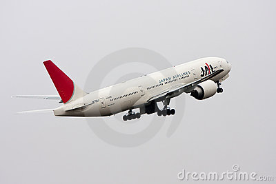 Japan Airlines Boeing 777 takes off. Editorial Stock Image