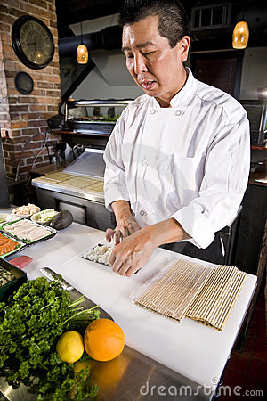 Free Japanese Chef In Restaurant Making Sushi Roll Stock Photo - 15066380