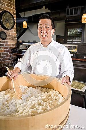 Japanese chef preparing rice for sushi