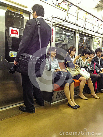 Japanese commuters on train Editorial Image