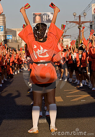Japanese festival dancers in orange hakama kimono Editorial Photography