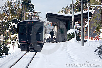 Japanese passenger train at station on a snowy day Editorial Stock Image