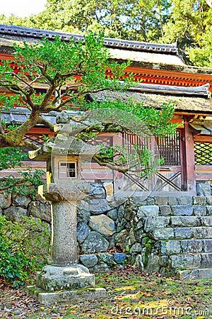 Free Japanese Stone Lantern And Temple Gates. Stock Photo - 83974860