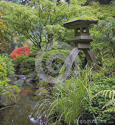 Japanese Stone Lantern by Water Stream