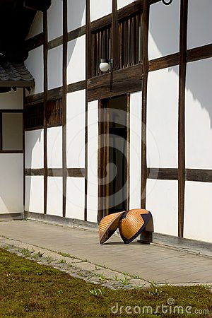 Japanese straw rain hats (amegasa) in temple yard