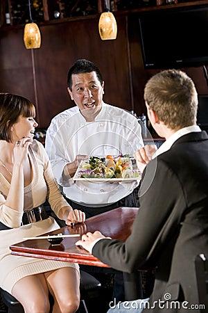 Japanese sushi restaurant, chef serving customers
