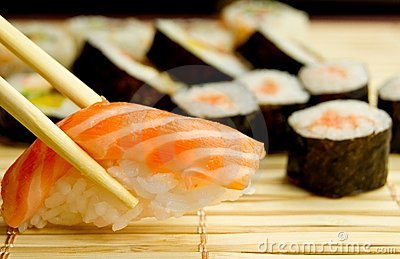 Japanese sushi. Tuna, sticks on bamboo napkin