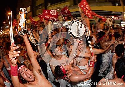Japanese tug of war winners celebrate Editorial Photography