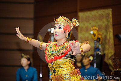 A Japanese woman perform Bali dance Editorial Stock Photo