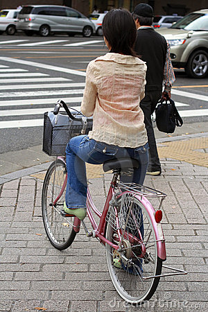 Japanese woman riding bicycle