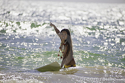Japanese woman surfing in hawaii