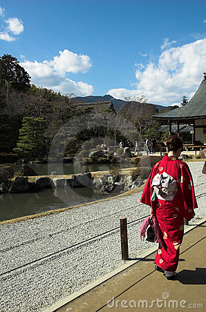 A Japanese woman in traditional dress at a temple in Kyoto