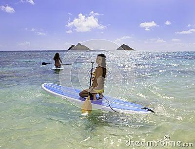 Japanese women on paddleboards