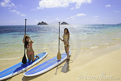 Japanese women on paddleboards