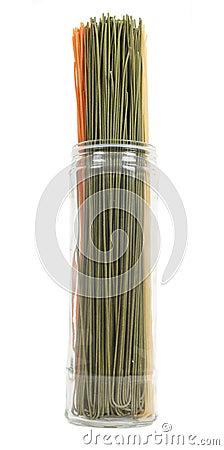 Jar of colourful pasta