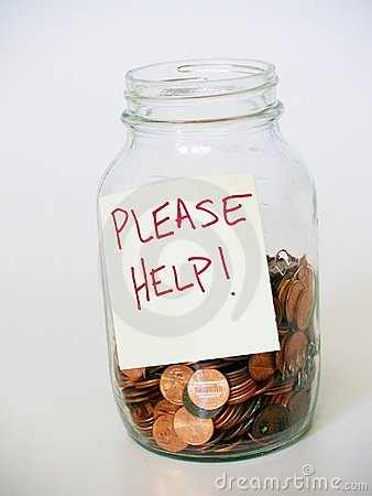 Jar full of pennies with PLEASE HELP sign