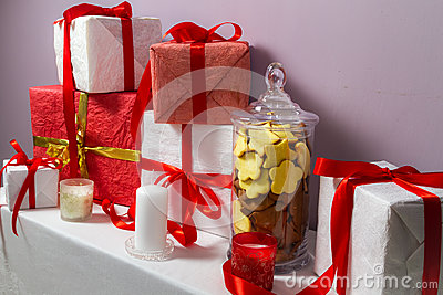 Jar of gingerbread cookies and Christmas gifts
