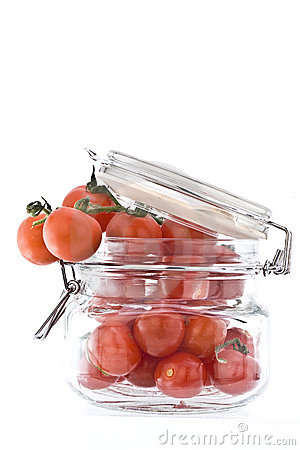 Jar holding small vine Tomatoes