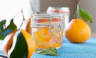 Jar of homemade orange jam with wide aspect ratio