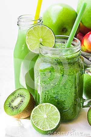 Free Jar Mug With Green Vegetable Smoothie, Bottle With Fruit Juice, Scattered Kiwi, Limes, Apples Stock Images - 87672374