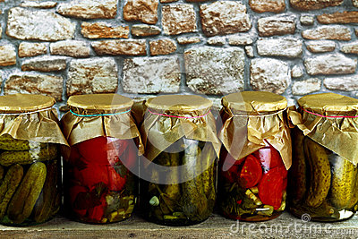 Jars with cucumbers tomatoes