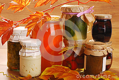 Jars of homemade preserves in autumn scenery