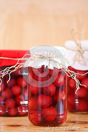 Free Jars With Cherry Compote Royalty Free Stock Photos - 25516308