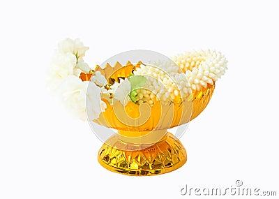 Jasmine garland on gold tray