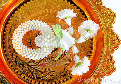 Jasmine garland on gold tray