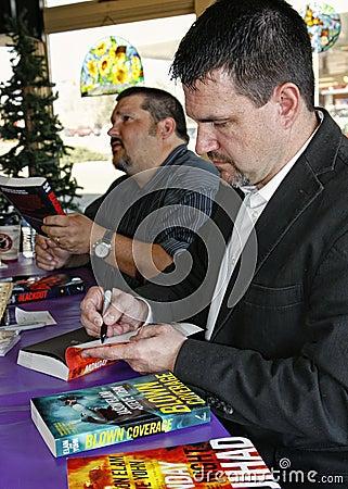 Jason Elam and Steve Yohn autograph Their Novels Editorial Image