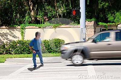 Jaywalking man about to be run over by truck