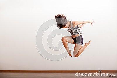 Jazz dancer performing a jump