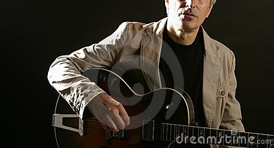 Jazz guitar player playing instrument