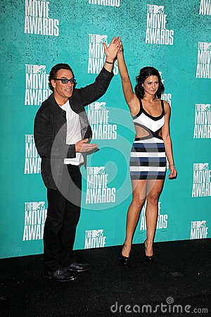 Jean-Claude Van Damme, Bianca Van Damme at the 2012 MTV Movie Awards Press Room, Gibson Amphitheater, Universal City, CA 06-03-12 Editorial Image