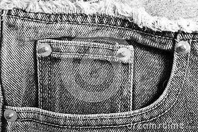 Closeup of black denim jean pockets