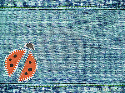 Jeans background with ladybug
