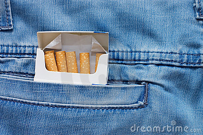 Jeans pocket with a packet of cigarettes