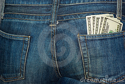 Jeans rear pocket with $100 banknotes