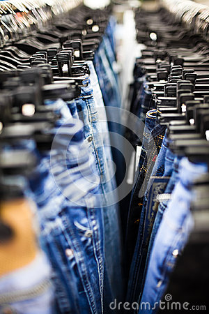 Jeans and trousers on hangers
